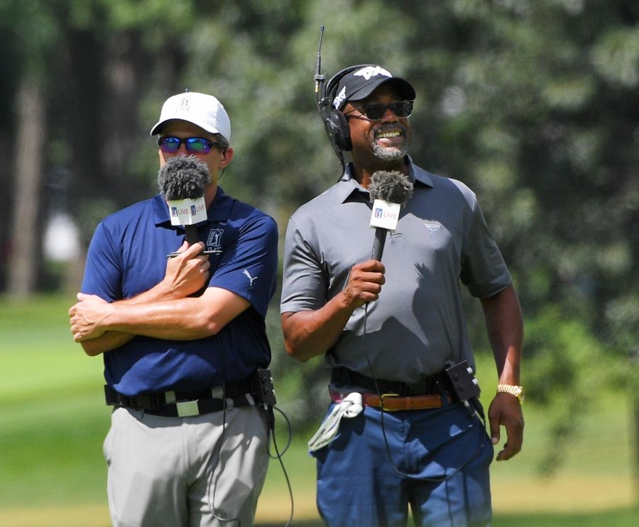 Musician Darius Rucker, right, broadcasts live from the 14th fairway Thursday during the first round of the BMW Championship at Medinah Country Club.