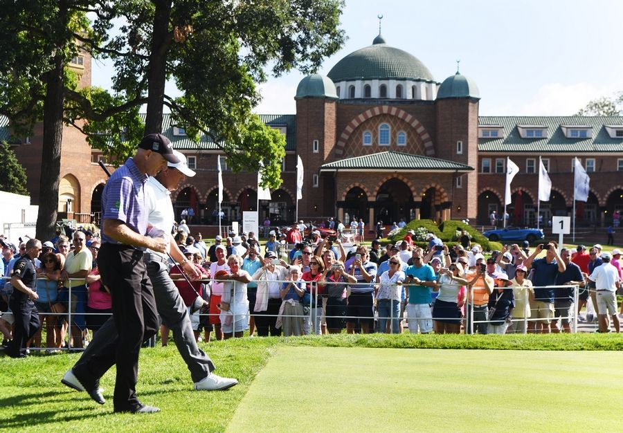 Jim Furyk, left, and Phil Mickelson walk together after teeing off during the opening round of the BMW Championship at Medinah.