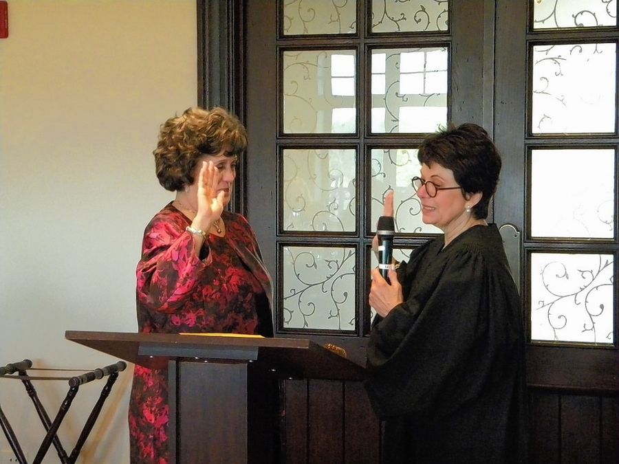 The Honorable Pamela Loza, right, swears in Attorney Miriam Cooper as the new Northwest Suburban Bar Association president.