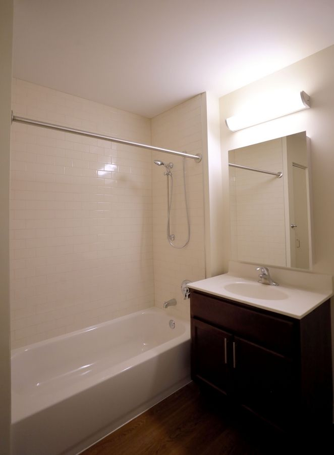 Some bathrooms at Heart's Place feature a low tub and shower with handle for residents with physical disabilities. individuals.