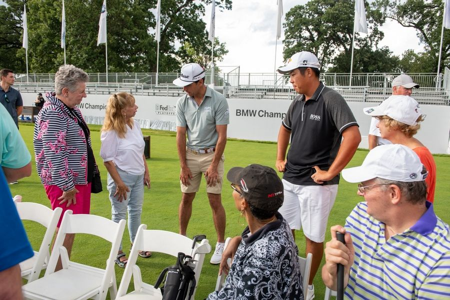 PGA Tour pros Rafa Cabrera Bello and Byeong-Hun (Ben) An offer golfers from the Marianjoy Rehabilitation Hospital therapeutic golf program one-on-one advice at the BMW Championship.