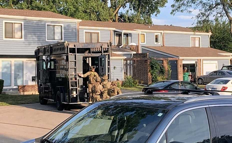Illinois State Police prepare Thursday to ram a townhouse in Wheeling during a confrontation in which an officer was shot.