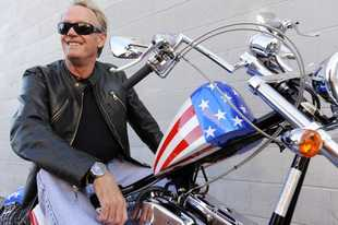 "FILE - In this Friday, Oct. 23, 2009 file photo, Peter Fonda, poses atop a Harley-Davidson motorcycle in Glendale, Calif. Fonda, the son of a Hollywood legend who became a movie star in his own right both writing and starring in counterculture classics like ""Easy Rider,� has died. His family says in a statement that Fonda died Friday, Aug. 16, 2019, at his home in Los Angeles. He was 79. (AP Photo/Chris Pizzello, File)"