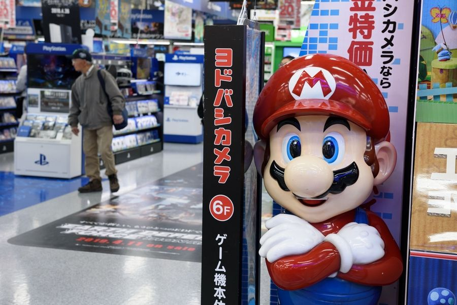 A statue of Nintendo Co.'s video game character Mario stands at an electronics store in Tokyo on April 12, 2019.
