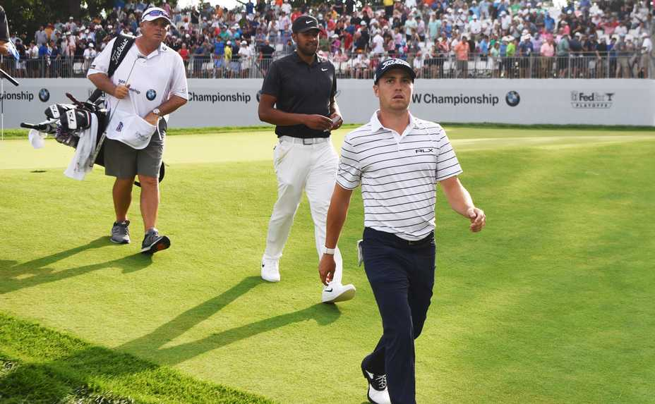 Justin Thomas, left, who finished with a 61 for the day and 21 under par through the third round of the BMW Championship at Medinah, heads to the clubhouse a few steps ahead of playing partner Tony Finau Saturday.