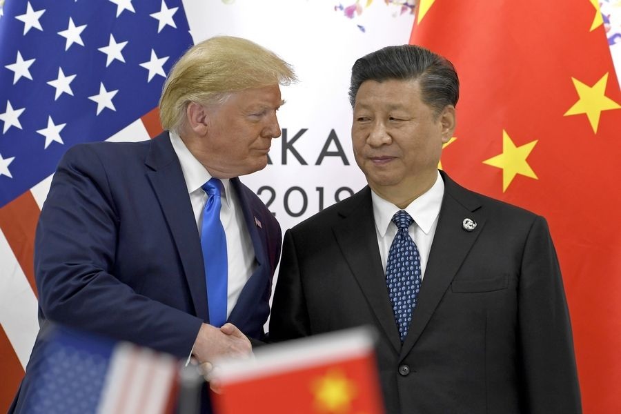 FILE -- In this June 29, 2019, file photo, U.S. President Donald Trump, left, shakes hands with Chinese President Xi Jinping during a meeting on the sidelines of the G-20 summit in Osaka, western Japan.