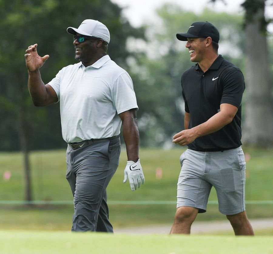 Brooks Koepka chats with playing partner Bo Jackson during the BMW Championship pro-am at Medinah Wednesday.