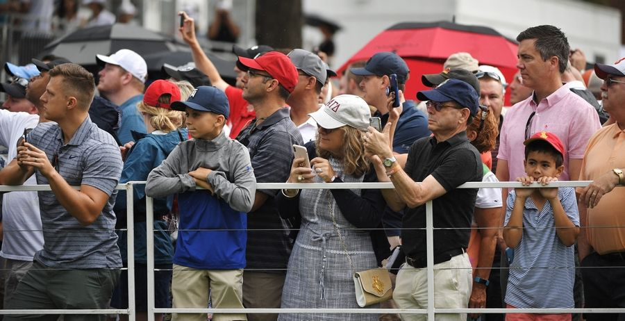 Fans watch as Tiger Woods gets ready to tee off during the third round of the BMW Championship at Medinah Saturday.