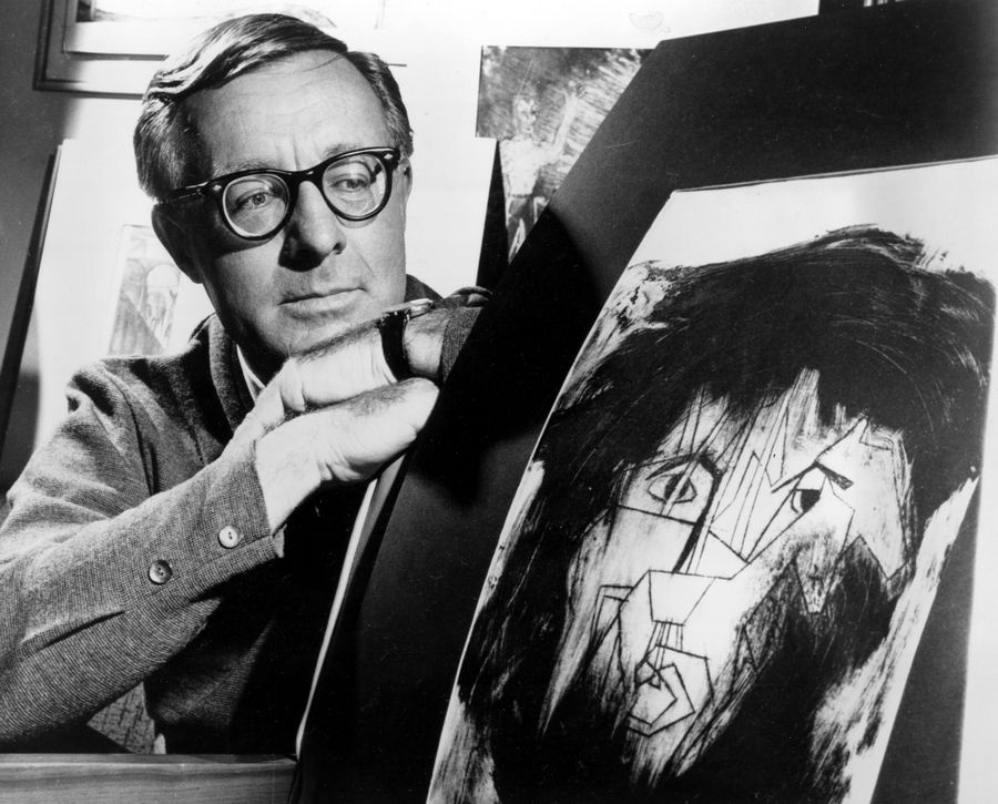 Iconic science fiction writer Ray Bradbury looks at a picture that was part of a school project to illustrate characters in one of his dramas in Los Angeles. A fundraising campaign kicks off this week for a Ray Bradbury museum in his childhood hometown Waukegan.
