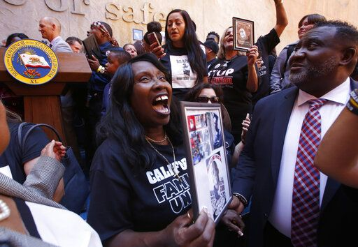Sequitta Thompson, the grandmother of Stephon Clark, an unarmed vandalism suspect who was shot and killed by two Sacramento police officers last year, celebrates after a measure to limit the police use of deadly force was signed by Gov. Gavin Newsom, in Sacramento, Calif., Monday, Aug. 19, 2019. The bill AB392, by Assmblywoman ShirleyWeber, D-San Diego, would bar police from using lethal force unless it is necessary to prevent imminent threat of death or serious injury to themselves and others.