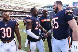 Benny Cunningham, left, Jordan Howard, middle, and Cody Whitehair of the Chicago Bears celebrate their team's win over the Green Bay Packers during Sunday's game at Soldier Field in Chicago last December. Whitehair returned to practice Tuesday, six days after suffering a finger injury on his left hand.