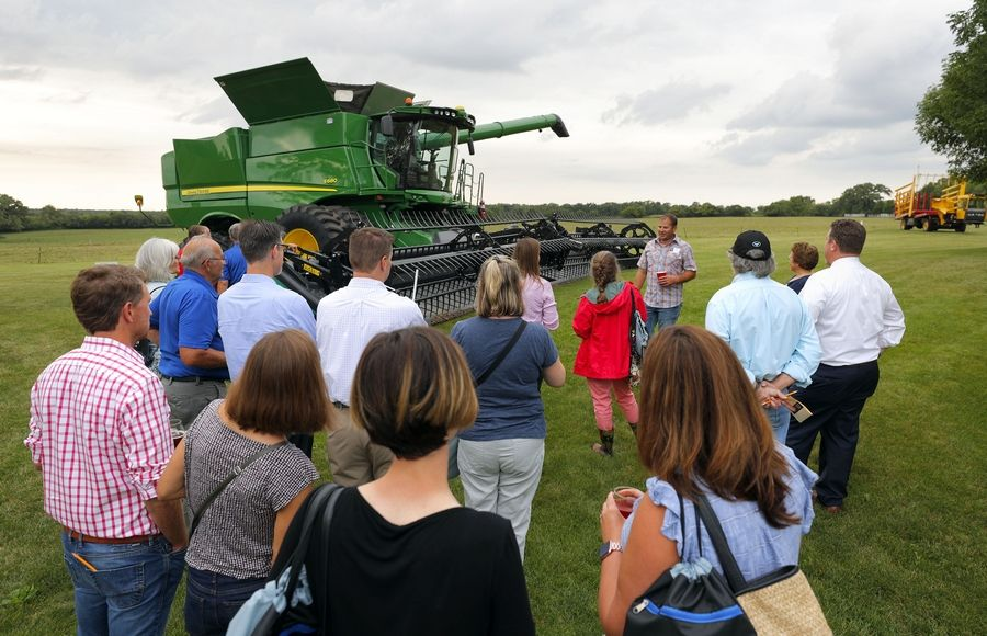 Steve Lundy/slundy@dailyherald.comFarmer Andy Yarc of Libertyville shows guests his combine as The Lake County Farm Bureau held its first legislative dinner and reception at Yarc Farms around Libertyville Wednesday.