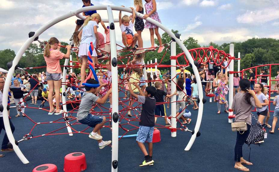 Children enjoy a new inclusive playground meant to be fun for everyone regardless of physical abilities at Countryside Elementary School in Barrington Hills.
