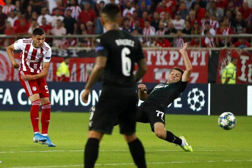 Olympiakos' Lazar Randelovic, left, scores his side's third goal during the Champions League qualifying playoff first leg soccer match between Olympiakos and Krasnodar at Georgios Karaiskakis stadium in Piraeus port, near Athens, Wednesday, Aug. 21, 2019.