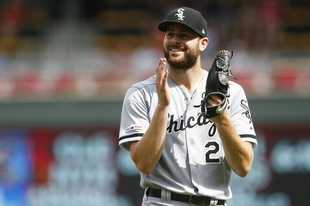 Chicago White Sox pitcher Lucas Giolito applauds the final out after pitching a complete three-hit shutout game against the Minnesota Twins in a baseball game Wednesday, Aug. 21, 2019, in Minneapolis. The White Sox won 4-0. (AP Photo/Jim Mone)