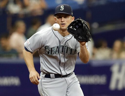 Seattle Mariners third baseman Kyle Seager fields a ground ball by Tampa Bay Rays' Michael Brosseau during the third inning of a baseball game Wednesday, Aug. 21, 2019, in St. Petersburg, Fla. Brosseau was out at first.