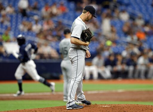 Seattle Mariners pitcher Wade LeBlanc reacts as Tampa Bay Rays' Guillermo Heredia runs around the bases after his solo home run during the third inning of a baseball game Wednesday, Aug. 21, 2019, in St. Petersburg, Fla.