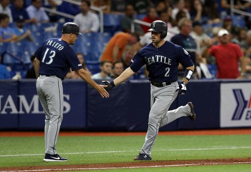 Seattle Mariners' Tom Murphy (2) shakes hands with third base coach Chris Prieto (13) after Murphy hit a two-run home run off Tampa Bay Rays relief pitcher Jalen Beeks during the sixth inning of a baseball game Tuesday, Aug. 20, 2019, in St. Petersburg, Fla.
