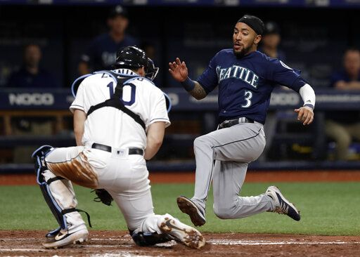 Seattle Mariners' J.P. Crawford (3) tries to score on a single by Austin Nola during the fifth inning of a baseball game Tuesday, Aug. 20, 2019, in St. Petersburg, Fla. Tampa Bay Rays catcher Mike Zunino (10) tagged Crawford out.