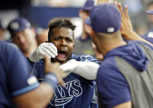Tampa Bay Rays' Guillermo Heredia celebrates with teammates in the dugout after his solo home run off Seattle Mariners' Wade LeBlanc during the third inning of a baseball game Wednesday, Aug. 21, 2019, in St. Petersburg, Fla.