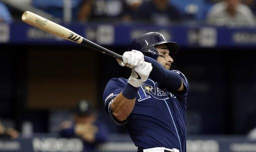 Tampa Bay Rays' Kevin Kiermaier lines a two-run single off Seattle Mariners' Wade LeBlanc during the fourth inning of a baseball game Wednesday, Aug. 21, 2019, in St. Petersburg, Fla.