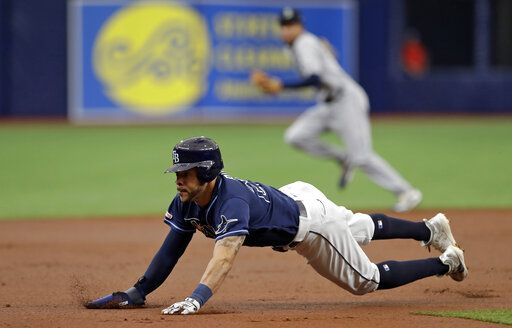 Tampa Bay Rays' Tommy Pham steals third base against the Seattle Mariners during the first inning of a baseball game Wednesday, Aug. 21, 2019, in St. Petersburg, Fla.