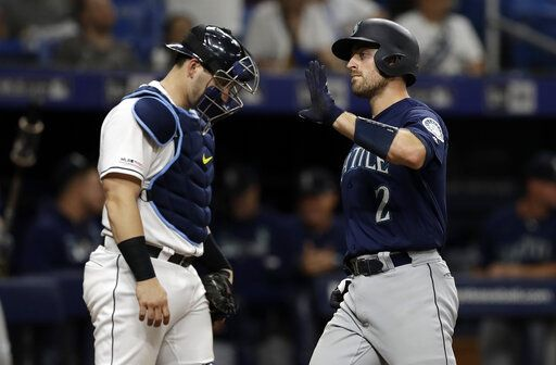 Seattle Mariners' Tom Murphy (2) celebrates his two-run home run off Tampa Bay Rays relief pitcher Jalen Beeks during the sixth inning of a baseball game Tuesday, Aug. 20, 2019, in St. Petersburg, Fla. Catching for the Rays is Mike Zunino.