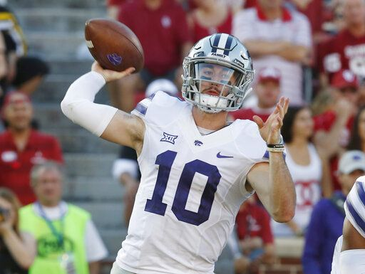 FILE - In this Oct. 27, 2018, file photo, Kansas State quarterback Skylar Thompson (10) throws in the second of an NCAA college football game against Oklahoma in Norman, Okla. Skylar Thompson went through the ringer his first two seasons in Manhattan, never quite feeling confident of himself under longtime coach Bill Snyder. But with the arrival of Chris Klieman, the junior signal-caller has taken over the leadership of a team that has bowl expectations under its new head coach.