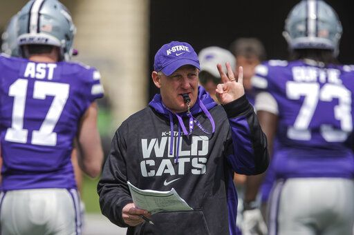 FILE - In this April 14, 2019, file photo, Kansas State head coach Chris Klieman leads his team through their final NCAA college spring football practice in Manhattan, Kan. Kansas State quarterback Skylar Thompson went through the ringer his first two seasons in Manhattan, never quite feeling confident of himself under longtime coach Bill Snyder. But with the arrival of Chris Klieman, the junior signal-caller has taken over the leadership of a team that has bowl expectations under its new head coach. (Travis Heying/The Wichita Eagle via AP, File)