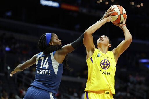 Minnesota Lynx center Temi Fagbenle, left, blocks a shot by Los Angeles Sparks forward Candace Parker during the second half of a WNBA basketball game in Los Angeles, Tuesday, Aug. 20, 2019.