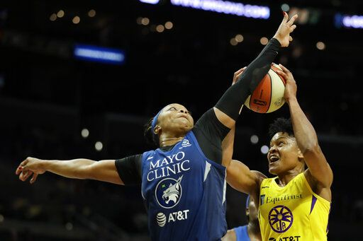 Minnesota Lynx guard Odyssey Sims blocks Los Angeles Sparks guard Alana Beard during the second half of a WNBA basketball game in Los Angeles, Tuesday, Aug. 20, 2019.