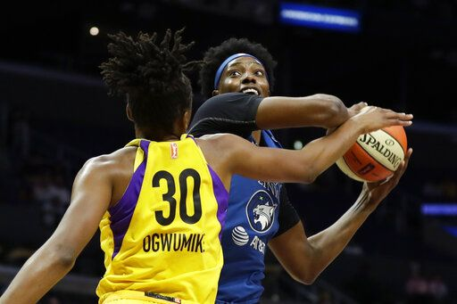 Los Angeles Sparks forward Nneka Ogwumike, left, blocks a shot by Minnesota Lynx center Sylvia Fowles during the first half of a WNBA basketball game in Los Angeles, Tuesday, Aug. 20, 2019.