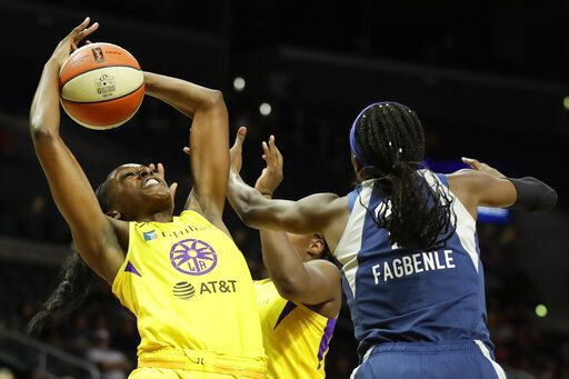 Los Angeles Sparks forward Chiney Ogwumike, left, vies for a rebound with Minnesota Lynx center Temi Fagbenle during the first half of a WNBA basketball game in Los Angeles, Tuesday, Aug. 20, 2019.