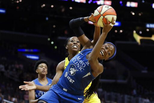 Los Angeles Sparks forward Chiney Ogwumike, back, fouls Minnesota Lynx center Temi Fagbenle during the first half of a WNBA basketball game in Los Angeles, Tuesday, Aug. 20, 2019.