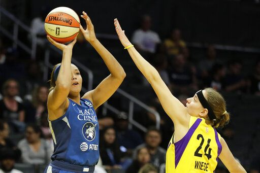 Minnesota Lynx forward Damiris Dantas shoots over Los Angeles Sparks guard Sydney Wiese during the first half of a WNBA basketball game in Los Angeles, Tuesday, Aug. 20, 2019.