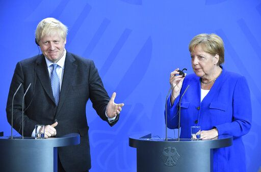 "Germany's Chancellor Angela Merkel and British Prime Minister Boris Johnson attend a joint press conference, in Berlin, Wednesday, Aug. 21, 2019. German Chancellor Angela Merkel says she plans to discuss with UK Prime Minister Boris Johnson how Britain's exit from the European Union can be ""as frictionless as possible."" (Bernd Von Jutrczenka/dpa via AP)"