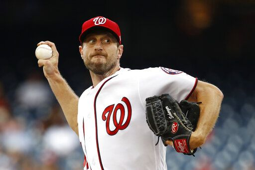 "FILE - In this July 25, 2019, file photo, Washington Nationals starting pitcher Max Scherzer throws to the Colorado Rockies during a baseball game in Washington. Three-time Cy Young Award winner Max Scherzer says he is ""ready to get in a game� for the Washington Nationals and come off the injured list. Scherzer played catch at Nationals Park on Wednesday, Aug. 14. a day after throwing the equivalent of about two innings in a simulated game, and said he felt able to return to action from a back muscle problem."
