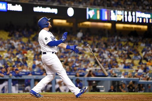 Los Angeles Dodgers' Max Muncy drops his bat after hitting a game-ending solo home run during the 10th inning of the the team's baseball game against the Toronto Blue Jays on Wednesday, Aug. 21, 2019, in Los Angeles. The Dodgers won 2-1.