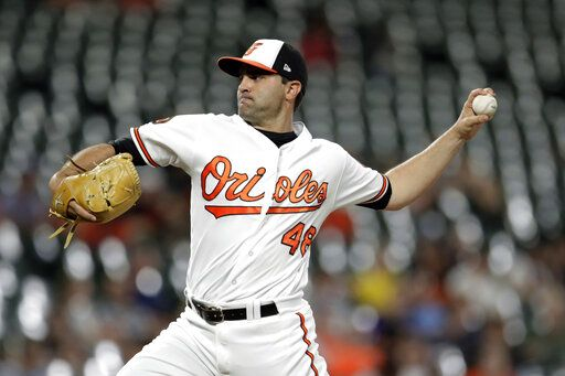 Baltimore Orioles relief pitcher Richard Bleier throws a pitch to a Kansas City Royals batter during the seventh/eight inning of a baseball game, Wednesday, Aug. 21, 2019, in Baltimore. The Orioles won 8-1.