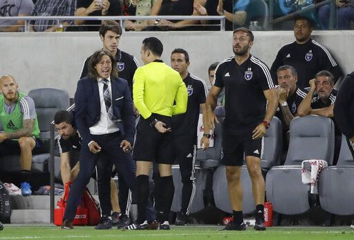 San Jose Earthquakes coach Matias Almeyda, left, argues a call with an official during the first half of the team's MLS soccer match against Los Angeles FC on Wednesday, Aug. 21, 2019, in Los Angeles.