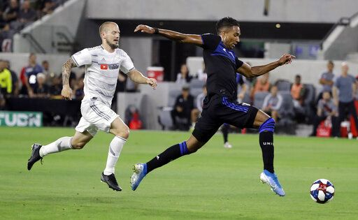 San Jose Earthquakes forward Danny Hoesen, right, dribbles past Los Angeles FC defender Jordan Harvey during the first half of an MLS soccer match Wednesday, Aug. 21, 2019, in Los Angeles.