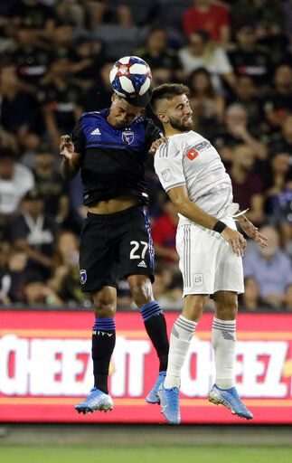 San Jose Earthquakes defender Marcos Lopez (27) works for a header next to Los Angeles FC forward Diego Rossi during the first half of an MLS soccer match Wednesday, Aug. 21, 2019, in Los Angeles.