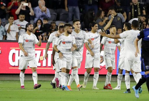 Los Angeles FC forward Carlos Vela, with arm raised, celebrates with teammates after scoring on a penalty kick against the San Jose Earthquakes during the first half of an MLS soccer match Wednesday, Aug. 21, 2019, in Los Angeles.
