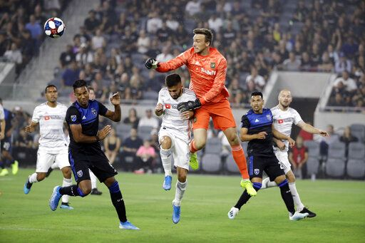 Los Angeles FC goalkeeper Tyler Miller, center right, clears the ball next to forward Diego Rossi, center left, during the first half of the team's MLS soccer match against the San Jose Earthquakes on Wednesday, Aug. 21, 2019, in Los Angeles.