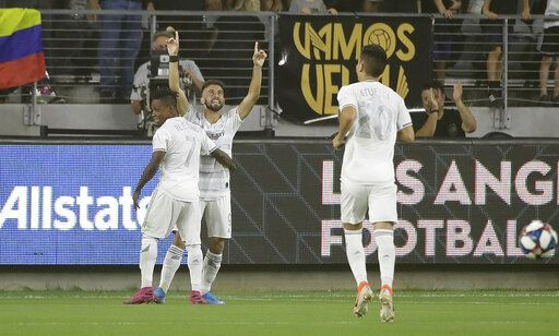 Los Angeles FC's Diego Rossi, center, celebrates his goal with teammate Latif Blessing (7) during the first half of the team's MLS soccer match against the San Jose Earthquakes on Wednesday, Aug. 21, 2019, in Los Angeles.