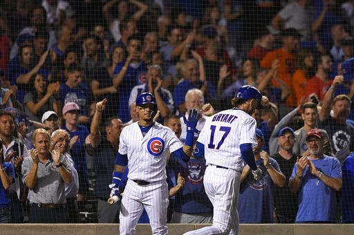 Chicago Cubs' Kris Bryant (17) celebrates with Javier Baez left, after hitting a two-run home run during the eighth inning of the team's baseball game against the San Francisco Giants on Wednesday, Aug 21, 2019, in Chicago. Chicago won 12-11.