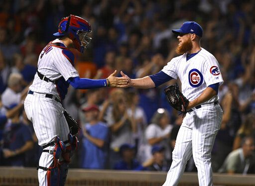 Chicago Cubs closing pitcher Craig Kimbrel right, celebrates with catcher Victor Caratini after the Cubs defeated the San Francisco Giants 12-11 in a baseball game Wednesday, Aug 21, 2019, in Chicago.