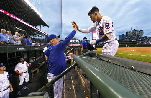 Chicago Cubs' Nicholas Castellanos right, celebrates with manager Joe Maddon at the dugout after hitting a two-run home run during the first inning of the team's baseball game against the San Francisco Giants on Wednesday, Aug 21, 2019, in Chicago.