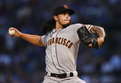 San Francisco Giants starter Dereck Rodriguez delivers a pitch during the first inning of the team's baseball game against the Chicago Cubs on Wednesday, Aug 21, 2019, in Chicago.