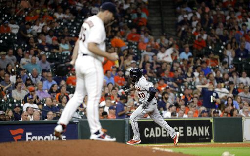 Detroit Tigers' Ronny Rodriguez (60) runs the bases after hitting a home run off Houston Astros starting pitcher Justin Verlander, left, during the fifth inning of a baseball game Wednesday, Aug. 21, 2019, in Houston.
